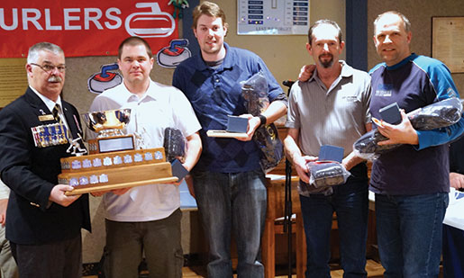 Poirier presents the trophy to the winning team from B.C./Yukon Command  of (from left) Dave Belway, Darin Gerow, Wayne Shepherd and Barry Meyer. [PHOTO: ADAM DAY]
