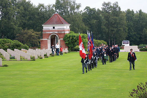 A colour party prepares for a memorial service during a Legion Youth Leaders' Pilgrimage of Remembrance at Holten Canadian War Cemetery near Deventer, Netherlands, 2009. [PHOTO: SHARON ADAMS, LEGION MAGAZINE]