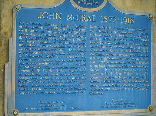 A plaque at Wimereux Communal Cemetery, near Boulogne, France, tells the story of the poem In Flanders Fields, and its author, Lt.-Col.John McCrae, who is buried here. [PHOTO: SHARON ADAMS, LEGION MAGAZINE]