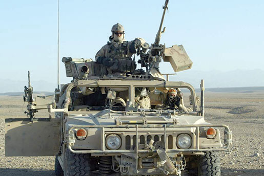 CSOR operators and their American Humvee patrol vehicle. [PHOTO: DEPARTMENT OF NATIONAL DEFENCE]