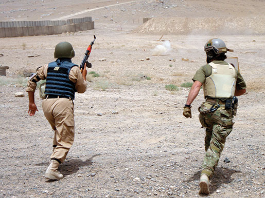 A CSOR operator conducts live-fire training with an Afghan counterpart. [PHOTO: DEPARTMENT OF NATIONAL DEFENCE]