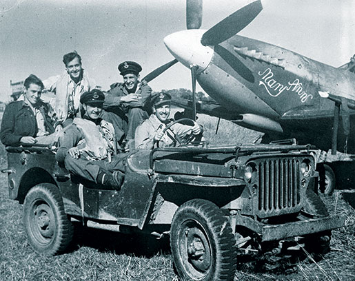 Squadron Leader Robert Day behind the wheel of a jeep, joined by other Far East personnel. [PHOTO: LIBRARY AND ARCHIVES CANADA—e011086438]