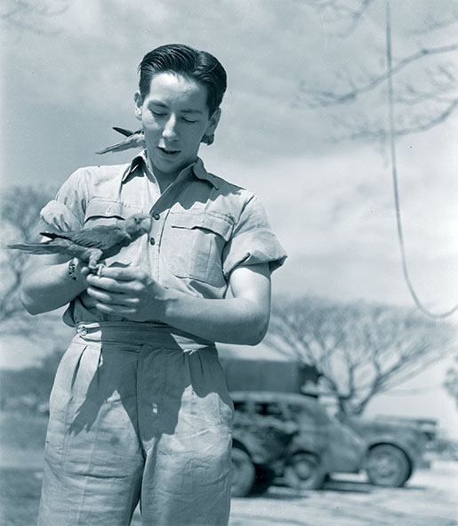 Pilot Officer A.R. Corston with a couple of feathered friends. [PHOTO: LIBRARY AND ARCHIVES CANADA—e011086437]