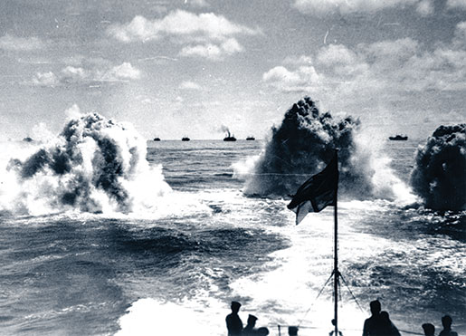 This undated photo shows depth charge explosions astern of HMCS Saguenay during convoy escort operations. [PHOTO: NATIONAL DEFENCE/LIBRARY AND ARCHIVES CANADA—PA116840]