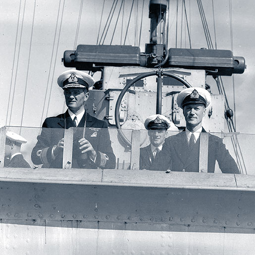 Lieutenant-Commander J.H. Stubbs (right) as seen in September 1940 on the bridge of HMCS Assiniboine with Commodore G.C. Jones. Note the ship's MF/DF antenna (two large circular tubes set at 90 degrees from each other) in the background. [PHOTO: NATIONAL DEFENCE/LIBRARY AND ARCHIVES CANADA—PA104263]