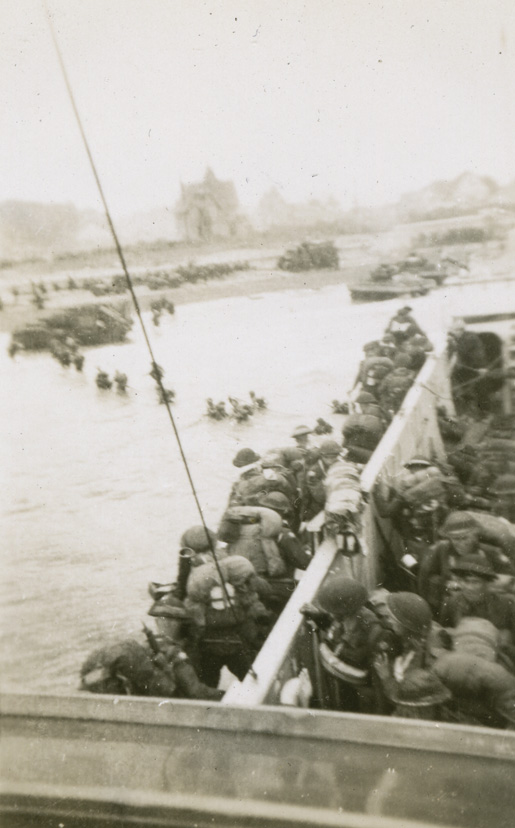 Canadian soldiers head into the water from a landing craft at Bernières-sur-Mer, June 6, 1944. [PHOTO: CANADIAN WAR MUSEUM—20020039-001_3c]
