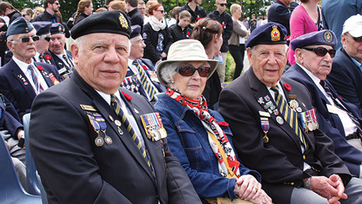 Veterans Pierre Bruneau (left) and Benoit Gauthier (third left) attend the ceremony at Bretteville-sur-Laize Canadian War Cemetery. [PHOTO: SHARON ADAMS]