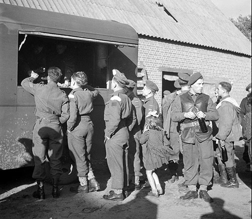 Canadian soldiers collect their beer ration at a canteen in the Netherlands, September 1944. [PHOTO: LIEUTENANT KEN BELL, LIBRARY AND ARCHIVES CANADA—PA168676]