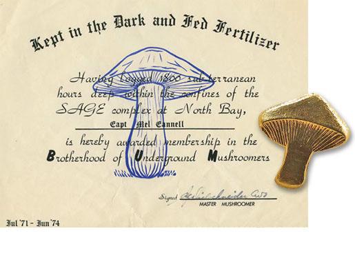 The Brotherhood of Underground Mushroomers certificate and the granite mushroom. [CANADIAN FORCES MUSEUM OF AEROSPACE DEFENCE]