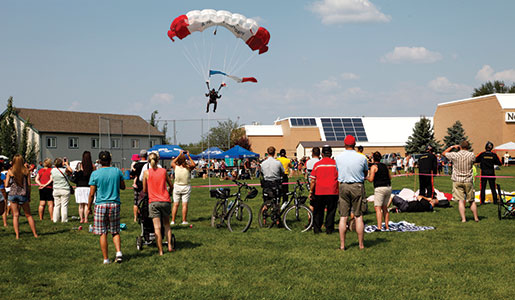 A member of the veterans' parachute team lands at an event in Slave Lake. [PHOTO: ADAM DAY]