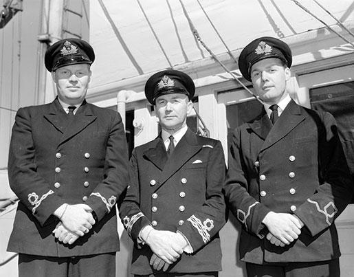 Oakville's officers, from left: Sub-Lieutenant K.D. Fenwick, Lieutenant-Commander Clarence King and Sub-Lieutenant E.G. Scott shown in September 1942. [PHOTO: GEORGE LAWRENCE, DEPARTMENT OF NATIONAL DEFENCE, LIBRARY AND ARCHIVES CANADA—PA106482]