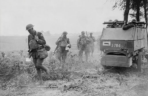 An armoured car equipped with machine guns supports soldiers near the front. [PHOTO: DEPARTMENT OF NATIONAL DEFENCE, LIBRARY AND ARCHIVES CANADA—PA003016]