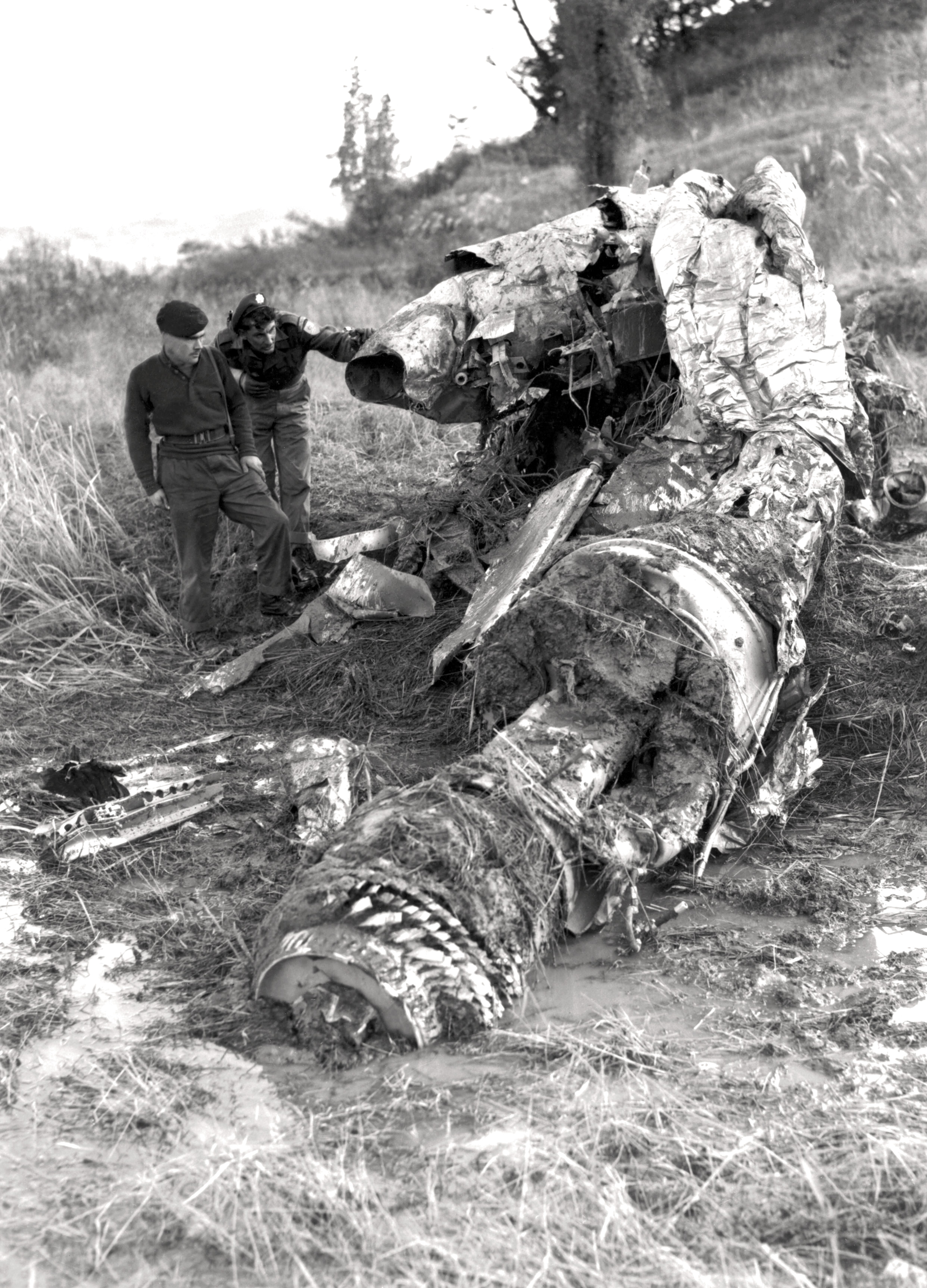 Historic Korean War Photo – Examining The Wreckage