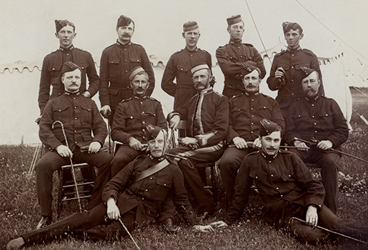 McCrae saw active military service in the Boer War as an artillery officer (back row, far left). [Guelph Civic Museum/M1968X.353.1.2]