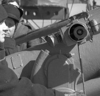 Navy personnel aboard HMCS St. Croix man a 4-inch gun on a cold day in March 1941. [DND/LAC/PA-105295]