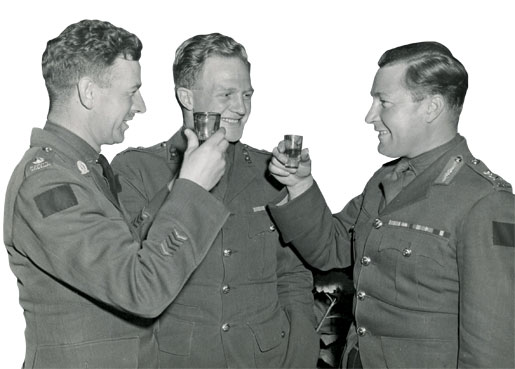 Maj-Gen. B.M. Hoffmeister celebrates victory on VE-Day with two of his senior officers, Lt-Col. C.H. Drury and Lt-Col. W.C. Dick. [Legion Magazine Archives]