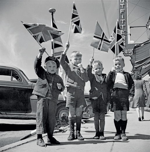 Children waving flags to celebrate VE-Day, Rouyn-Noranda, Que. [LAC/PA-193007]