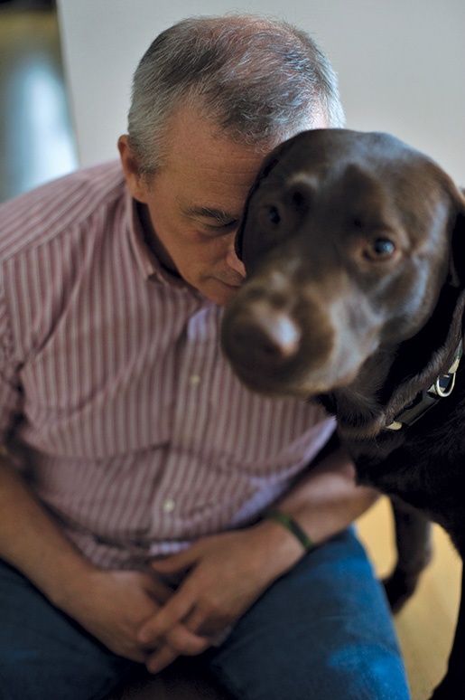 Retired colonel Pat Stogran, who lives with chronic pain and post-traumatic stress disorder, takes solace from his dog, Apollo. [LOUIE PALU]