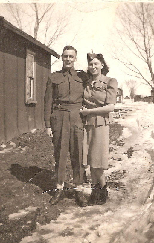 Jack and Florence Smith, with Florence wearing Jack's cap. Lance-Corporal Smith was killed in action in France on Aug. 10, 1944, just four days before his son's second birthday.