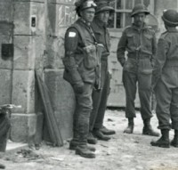 Street scene with Canadian soldiers and French civilians. [LAC/PA-162665]