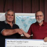 Br. 277 President, Ken Ward (L), donates $1000 to Howe Sound Curling Club (Youth), Rob Kirkham (R)