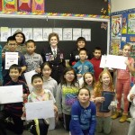 Comrade Catherine Schaff (middle) of Vancouver TVS Branch 44 presenting certificates to students at Admiral Seymour Elementary in Vancouver for participating in the Literary Poster Contest.