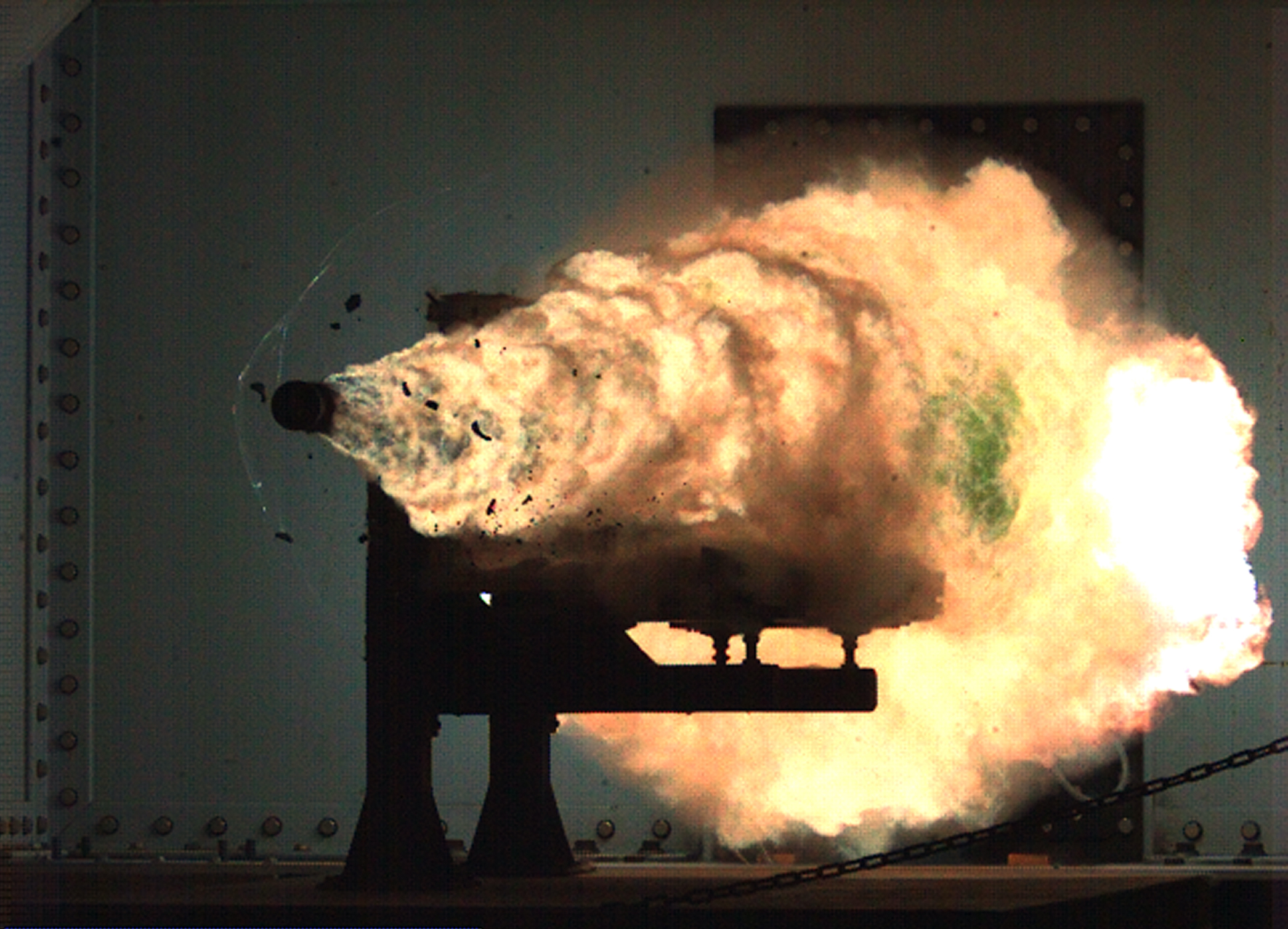 080131-N-0000X-001 DAHLGREN, Va. (Jan. 31, 2008) Photograph taken from a high-speed video camera during a record-setting firing of an electromagnetic railgun (EMRG) at Naval Surface Warfare Center, Dahlgren, Va., on January 31, 2008, firing at 10.64MJ (megajoules) with a muzzle velocity of 2520 meters per second. The Office of Naval ResearchÕs EMRG program is part of the Department of the NavyÕs Science and Technology investments, focused on developing new technologies to support Navy and Marine Corps war fighting needs. This photograph is a frame taken from a high-speed video camera. U.S. Navy Photograph (Released)