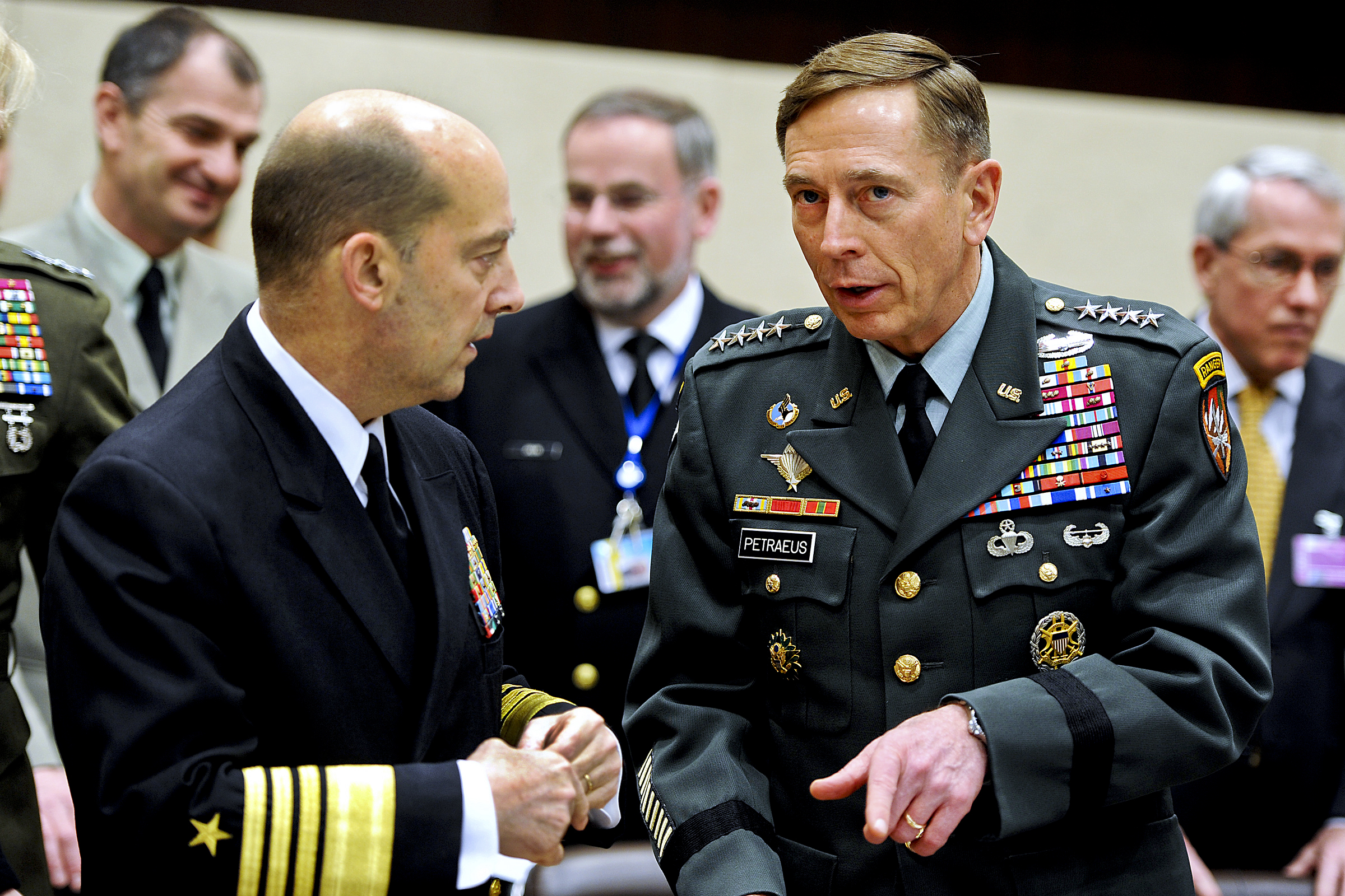 U.S. Army Gen. David H. Petraeus, right, Commander NATO International Security Assistance Force (ISAF) and U.S. Forces Afghanistan, speaks with Admiral James G. Stavridis, commander of European Command and Supreme Allied Commander, Europe, at the NATO headquarters in Brussels, Belgium March 11, 2011. Defense Department photo by Cherie Cullen (released)