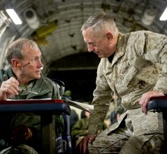 Central Command Commander Gen. James Mattis and Chairman of the Joint Chiefs of Staff Gen. Martin E. Dempsey talk on board a C-17 while in route to Baghdad, Iraq, Dec. 15,  2011.  DoD photo by D. Myles Cullen (released)