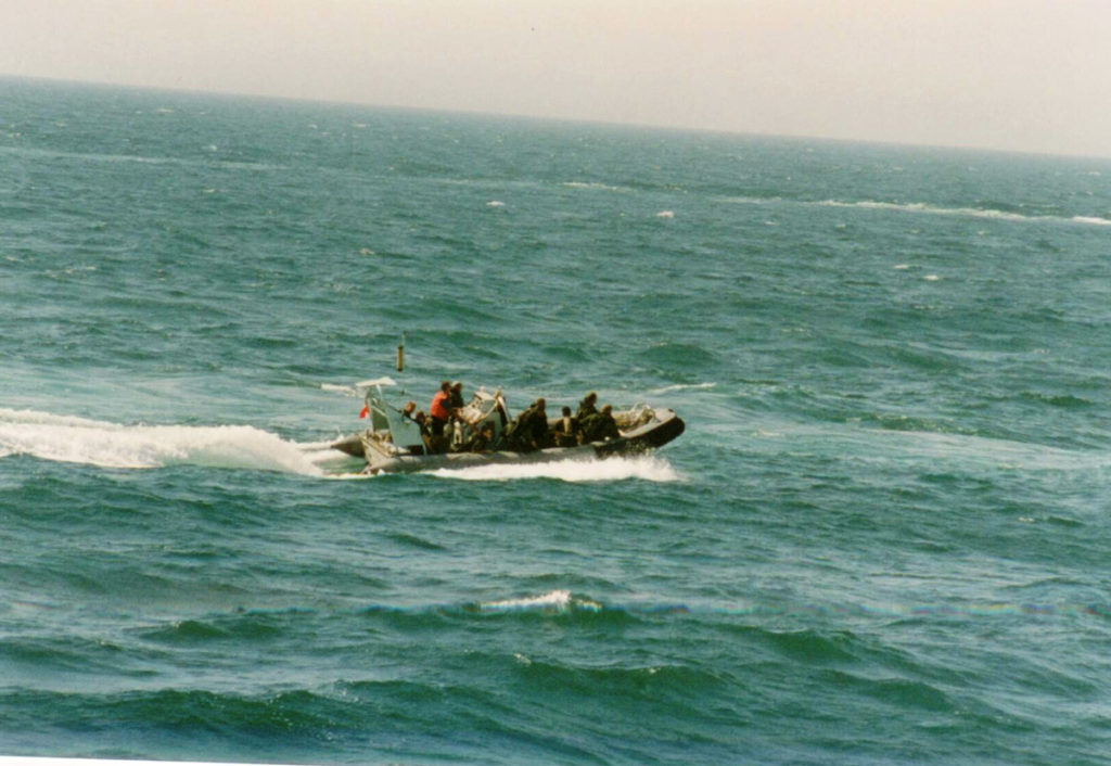 Members of HMCS Regina's naval boarding party make their way in a rigid-hulled inflatable boat to a vessel in the Gulf of Oman during the Afghanistan War.