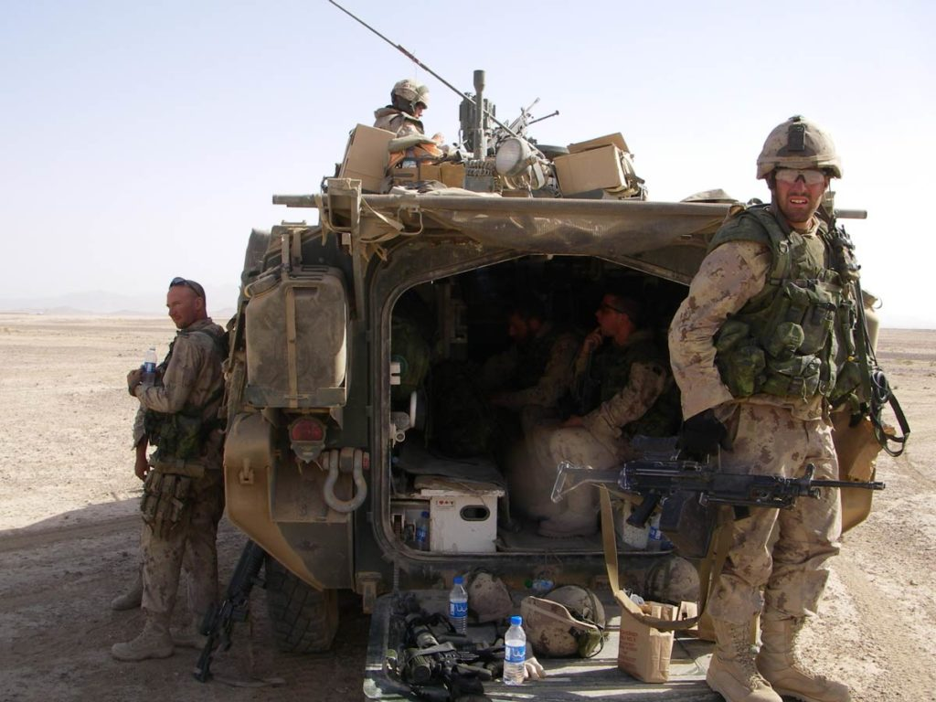 Cpl. Bruce Moncur (right) carrying a C9 machine gun in Afghanistan in 2006. Credit: BRUCE MONCUR