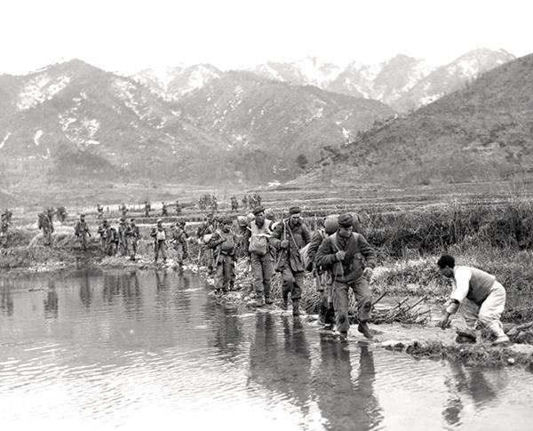 Patricias patrol a valley bottom in Korea in March 1951.