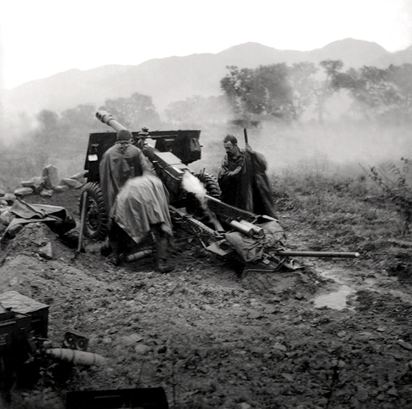 Fog and smoke surrounds a25-pounder gun of the 2ndField Regiment
