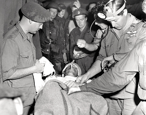 A severely wounded soldier gets first aid