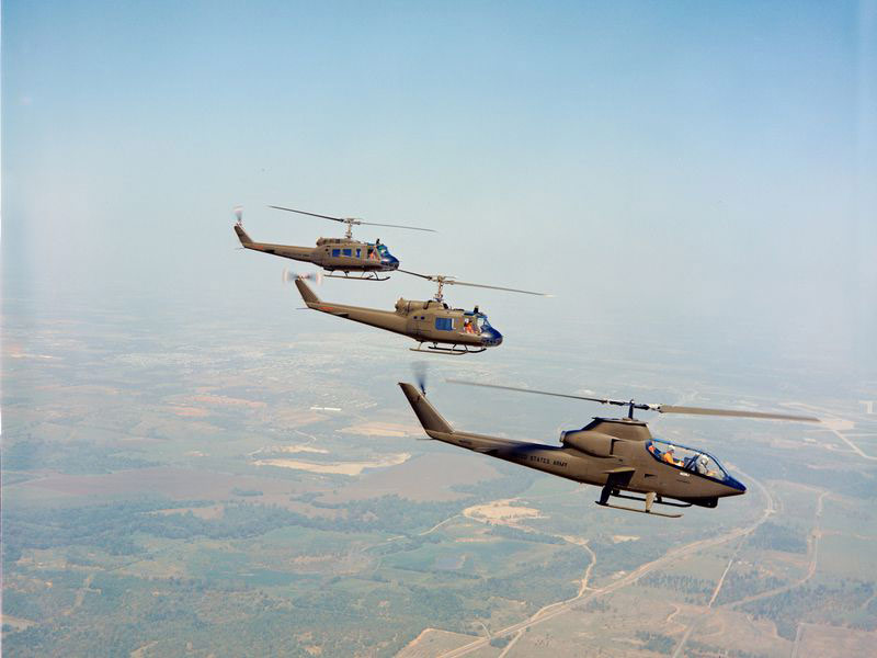 Bell Helicopter's prototype for the AH-1G Cobra flies ahead of two UH-1 Hueys, the aircraft it was designed to protect.