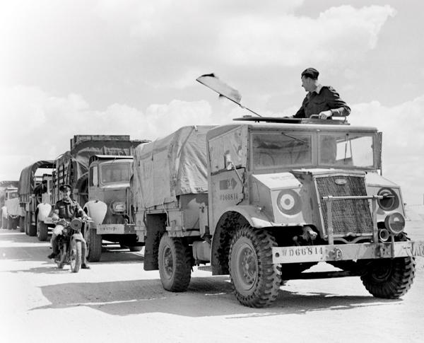 A convoy of CMP trucks